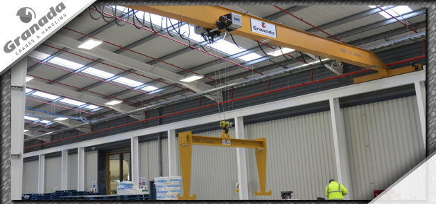 Custom lifting beam hung from an overhead crane