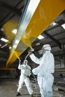 Spraying Overhead Cranes with a Kortec paint sprayer at Granada Cranes