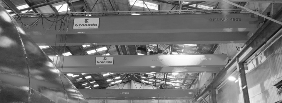 Overhead Cranes with double girders mounted on a shared gantry