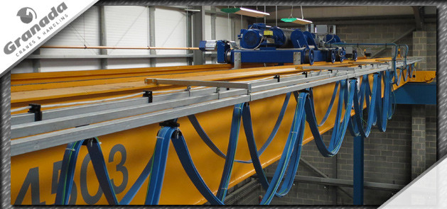 Twin open barrel hoists on a crane used to provide on wing support to the aviation industry