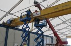 Overhead Crane installation, two engineers on scissor lifts and a mobile crane