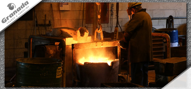 Pouring molten iron in a foundry