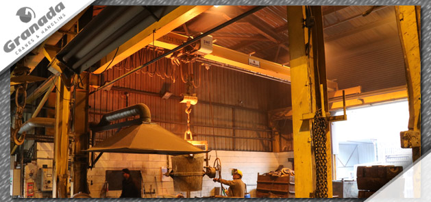 Overhead crane being used in a foundry