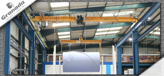 Paper reel loaded on overhead crane